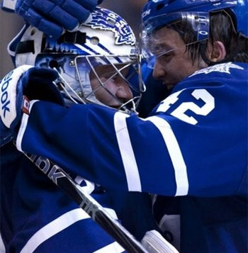 Tyler Bozak and James Reimer celebrate a victory